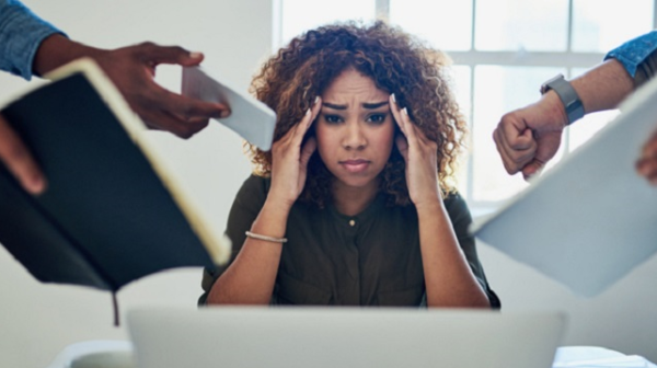 Image of stressed person in the workplace